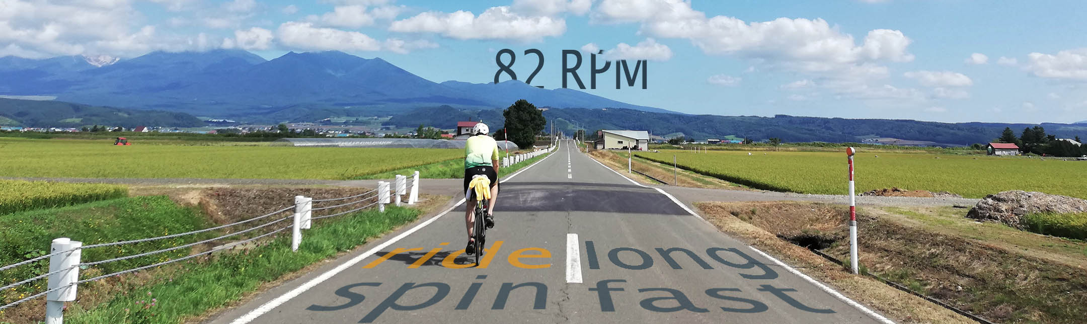 website cover. a road with a cyclist.